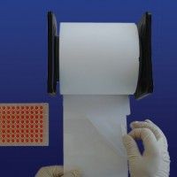 PlateSeal Film, Quick Apply Dispenser with Pre-Scored Sheets on a Roll. PS-PETRL-500